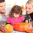 Family carving a pumpkin — Stock Photo #8919220