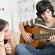 Young teenage couple with a guitar - Stock Photo