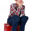 Bored female builder sat on tool box — Stock Photo #8919777