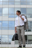 Man standing outside with his briefcase — Stock Photo