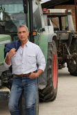 Farmer stood by tractor — Stock Photo