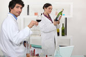 Man and woman testing wine in science laboratory — Stock Photo