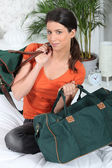 Young woman with travel bags — Stock Photo