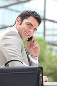 Businessman using a cellphone outside — Stock Photo