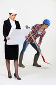 Worker and female architect — Stockfoto