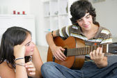 Young teenage couple with a guitar — Stock Photo
