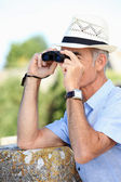 Man birdwatching — Stock Photo