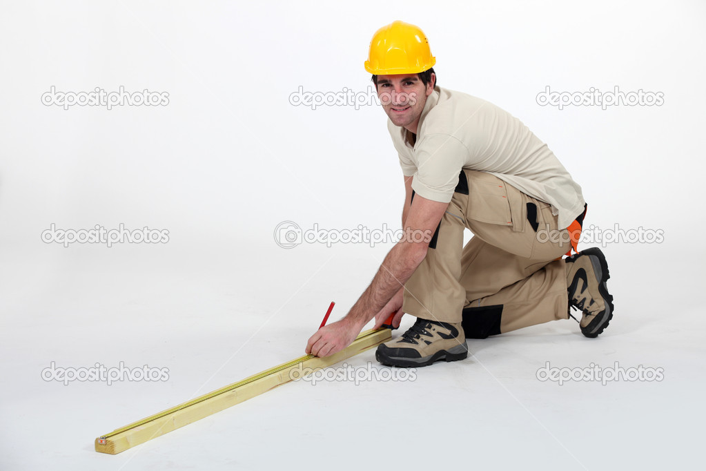 Workman taking measurements — Stock Photo #8913210