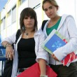 Two teenage girls going to their next lesson — Stock Photo #8920126