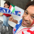 Man supporting the Italian national football team - Stock Photo