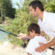Father and son fishing at a lake — Stock Photo #8922425