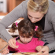 Mother giving pancakes to little girl — Stock Photo #8923315