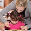 Stock Photo: Mother giving pancakes to little girl