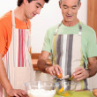 Stock Photo: Senior and junior cooking together