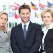 Stock Photo: Business in front of flags