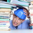 Stock Photo: An architect worry about his folders construction.