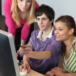 Three young looking at a computer — Stock Photo #8924013