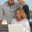 Stock Photo: Couple with laptop outdoors