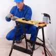 Plumber cutting copper pipe — Foto de Stock