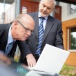 Two senior businessmen on a sales call — Stock Photo
