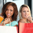 Women on a shopping spree — Stock Photo
