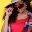 Woman wearing sunglasses and straw hat — Stock Photo #8925314