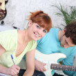 Couple songwriting with a guitar — Stock Photo