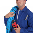Operator with blue tube roll — Stock Photo #8926377