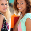 Two girls with shopping bags — Stock Photo