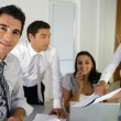 Businessteam gathered around desk — Stock Photo