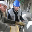 Zinc worker and apprentice in workshop — Stock Photo