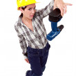 Confused woman holding drill - Stock Photo
