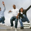 Three urban teenagers jumping down steps - Stock Photo