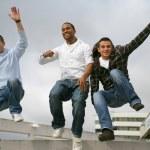 Three urban teenagers jumping down steps — Stock Photo #8928029