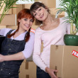 Mom and daughter packing - Stock Photo