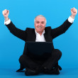 Successful businessman sitting on the floor — Stock Photo
