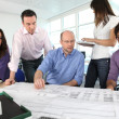 Stock Photo: Architects having a meeting