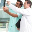Two male doctors looking an x-ray image — Stockfoto