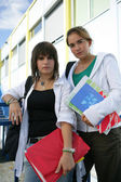 Two teenage girls going to their next lesson — Stock Photo
