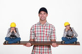 Construction manager balancing disgruntled staff — Stock Photo