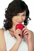 Flirtatious woman with heart in hand — Stock Photo