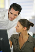 Colleagues working together in the office — Stock Photo