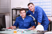 Two technicians working in office — Stock Photo
