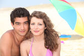 Young couple on the beach — Photo