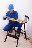 Plumber cutting copper pipe — Stock Photo