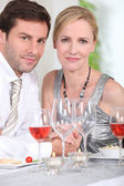 Couple drinking rose wine — Stock Photo