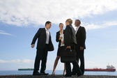 A team of businesspeople meeting on the quay — Stock Photo