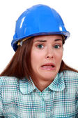 A terror-stricken tradeswoman — Stock Photo