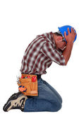 Furious craftsman on his knees — Stock Photo