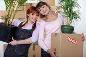 Mom and daughter packing — Stock Photo